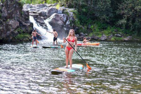 woman on paddle board in Umauma River